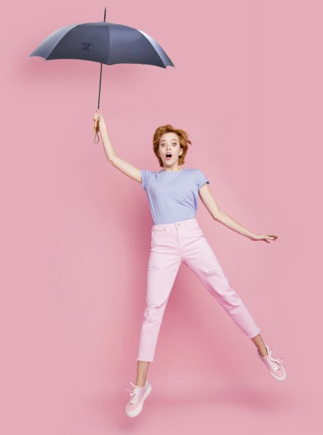 Full length body size view of her she nice cute charming attractive lovely feminine girl wearing casual jumping up in air wind blows having fun isolated on pink pastel background.